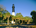 Hunting Island Lighthouse with Palm Trees and Blue Sky, Registered National Historic Landmark, Hunting Island State Park