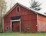 Old Red Barn with White Trim in Spring