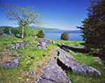 View of Lake Champlain from Crown Point State Historic Site in Spring with Rock Formations in Foreground, Adirondack Park