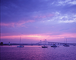 Sunset and Storm Clouds over Boats, Goat Island Lighthouse and Newport Bridge, Newport Harbor, Newport, RI