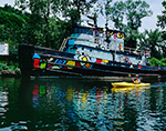 Colorful Old Tugboat with Kayaker on Rondout Creek off Hudson River, Hudson River Valley, Ulster County, Kingston, NY