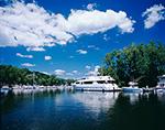 Motor Yacht under Blue Skyand White Clouds on Catskill Creek off Hudson River, Hudson River Valley, Greene County, Catskill, NY