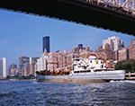 View of Manhattan at Queensboro Bridge with DEP Boat from East River, New York County, New York, NY