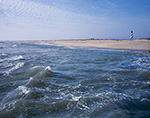 Surf in Atlantic Ocean with Beach and Cape Hatteras Light in Background, Cape Hatteras National Seashore, Outer Banks, NC