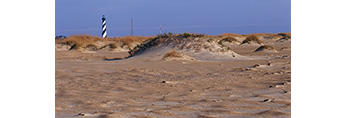 Beach and Dunes at Cape Hatteras National Seashore with Cape Hatteras Light in Background, Outer Banks, NC