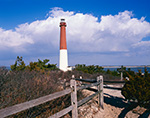 Barnegat Lighthouse and Split-rail Fence under Blue Sky and Cumulus Clouds, National Register of Historic Places, Barnegat Lighthouse State Park, Barnegat Light, NJ