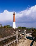 Barnegat Lighthouse and Split-rail Fence under Blue Sky and Cumulus Clouds, National Register of Historic Places, Barnegat Lighthouse State Park, Barnegat Light, NJ