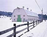 Big Barn with Green Doors and Split-rail Fence at Hogwash Farm in Winter, Norwich, VT