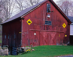 Old Red Barn with Yellow Tractor and Deer Crossing Signs, Orange, MA