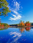 Harvard Pond in Fall with Blue Sky and White Clouds Reflected in Water, Petersham, MA