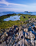 Rocks and Seaweed on South End of Bates Island with Jewell Island (left) and Cliff Island (right) in Background, Casco Bay, Cumberland, ME