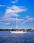 Sailboat in Ash Point Cove in Potts Harbor under Blue Sky and Cumulus Clouds, Casco Bay, Harpswell, ME
