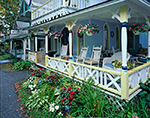 View of Porch on Yellow/Blue Gingerbread House with Rocking Chairs and Flowers, Martha's Vineyard, Oak Bluffs, MA