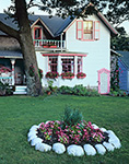 White and Pink Gingerbread House with White Rock Garden of Begonias in Front, Martha's Vineyard, Oak Bluffs, MA
