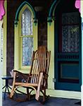 Wooden Rocking Chair on Porch of Yellow Gingerbread House, Martha's Vineyard, Oak Bluffs, MA