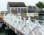"Wharf House ""Seaquin"" at End of Old North Wharf with White Railing along Walkway in Front, Nantucket Island, Nantucket, MA"
