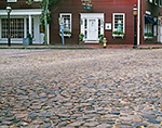 Close-up of Cobblestones on Main Street in Downtown Nantucket with Red Building in Background, Nantucket Island, Nantucket, MA