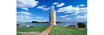 Avery Point Lighthouse with Brick Walkway under Blue Sky and White Puffy Clouds (Cumulus) at University of Connecticut, Groton, CT