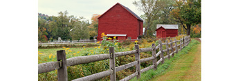 Wooden Fence and Red Farm in the Berkshires, Tyringham, MA