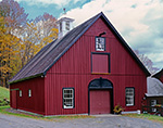 Dark Red Barn with White Cupola and Black and White Window Trim, South Woodstock, Woodstock, VT