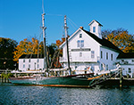 """Early Morning Light in Fall on the Connecticut River Museum with Schooner """"Mary E"""" at Dock in Front, Connecticut River, Essex, CT"""