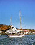 "Connecticut River Museum and Schooner ""Mary E"" at Dock in Fall with Yawl ""Chautaugua"" at Mooring in Foreground, Connecticut River, Essex, CT"