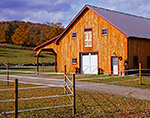 Natural Wood Horse Barn with White Doors and Red Trim,  West Windsor, VT