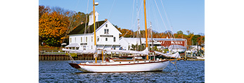 """Connecticut River Museum and Schooner """"Mary E"""" at Dock in Fall with Yawl """"Chautaugua"""" at Mooring in Foreground, Connecticut River, Essex, CT"""