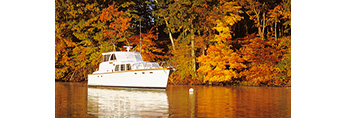 """Power Cruiser """"Seawagon"""" and Fall Foliage with Reflections in Hamburg Cove in Fall, Eightmile River, Popular Boating Spot on the Connecticut River, Lyme, CT"""