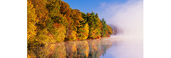 Early Morning Fog Rising over Fort Pond with Fall Foliage and Reflections along Shoreline, Lancaster, MA
