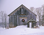 Old Wooden Barn with Holiday Wreath and Small Gray Wooden Shed at Cothelstone Farm, Royalston, MA
