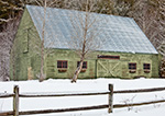 Green Wooden Barn with Red Trim with Split Rail Fence in Winter, Halifax, VT