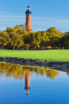Live Oak Trees and Currituck Beach Lighthouse Reflecting in Pond, Currituck Heritage Park, Outer Banks, Corolla, NC