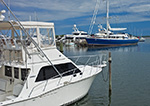 Sport Fishing Boat and Sailing Yacht at Docks in Sag Harbor, Long Island, Village of Sag Harbor, East Hampton, NY
