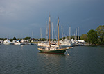 """Wooden Schooner """"Annie"""" in Evening Light with Storm and Brewer Marina in Background, Stirling Harbor, (Basin), Long Island, Village of Greenport, Southold, NY"""