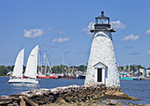 Palmer Island Lighthouse with 2-masted Sailboat and Commercial Fishing Boats at Fairhaven Shipyard in Background, New Bedford Harbor, New Bedford, MA