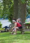 Two Women Enjoying Dutchmen's Landing Park on Hudson River, Hudson River Valley, Greene County, Catskill, NY