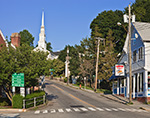 View up West Main Street to Union Baptist Church with Mystic Pizza on Right, Mystic, CT