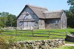Old Gray Barn with Thatched Roof, Split-rail Fence and Stone Wall on Mill Farm, Cape Cod, Yarmouth, MA