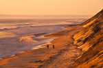 Surfers Walking along Cahoon Hollow Beach at Sunrise, Atlantic Ocean, Cape Cod National Seashore, Wellfleet, MA