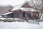 Weathered Wooden Barn with Holiday Wreath and Stone Wall in Winter, Jaffrey, NH