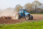 Farmer Tilling Fields in Spring with Blue Tractor, Blakely, Early County, GA