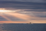Lobster Boat at Sunrise Heading Out from Christmas Cove under Dark Clouds, South Bristol, ME
