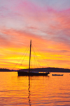 """Gaff-rigged Cutter Sailboat """"Vela"""" at Sunrise with Spruce Island in Background, between Deer Island Thorofare and Merchant Row, Stonington, ME"""