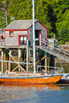 Boathouse with Wooden Sloop at Dock in Rockport Harbor, Rockport, ME