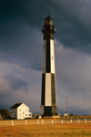 Evening LIght Shines on New Cape Henry Lighthouse with Dark Storm Clouds in Background, Fort Story, Virginia Beach, VA