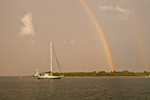 Stormy Skies with Rainbows over Sailboat Anchored on Sakonnet River near Third Beach, Middletown, RI