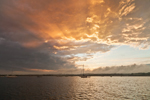 Setting Sun and Clearing Skies after Thunderstorm over Boats on Sakonnet River near Third Beach, Middletown, RI