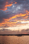 Sunset over Boats Anchored on Sakonnet River after Thunderstorm, near Third Beach, Middletown, RI