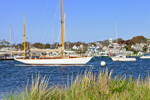 """Wooden Yawl """"Magic Carpet"""" and Boats in Edgartown Harbor with Village of Edgartown in Background, Martha's Vineyard, MA"""